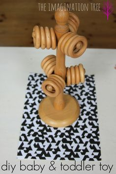 DIY stacking fine motor toy for babies and toddlers. So simple: wooden mug tree and curtain rings