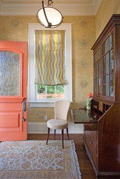 Traditional Entry by Adler Design Build Coral is cheerful. Like a ripe apricot or a beautiful sunrise, coral is a naturally uplifting color. Use it wherever you want a little boost — a coral front door would be spectacular.  This custom coral color is very similar to Sherwin Williams Gladiola, according to the designers.