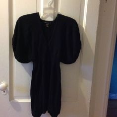 Long Sweater mini dress Long sweater dress has minor rips on top edges, nothing a needle and thread can't fix.  I tried to take picture but rip so tiny the picture would not come out.  This is a non-smoking  Forever Twenty One Sweaters V-Necks