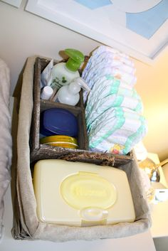 baby change table organization---make for downstairs on buffet next to pack n play.