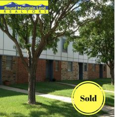 Round Mountain Land has sold these beautiful townhomes.Anothe satisfied customer!  If you are looking for a commercial or residential property, call  Round Mountain Land realtors.