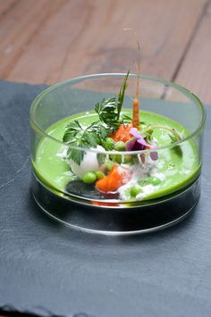 Pea, Carrot, and Coconut: Carrot Sorbet, Coconut Sphere, Freeze-dried Coconut, Pea and Mint Soup.    Atelier Crenn - San Francisco, CA, USA.