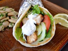 Chicken Shawarma .... Marinade makes chicken so moist and delicious and the sauce is delicious.