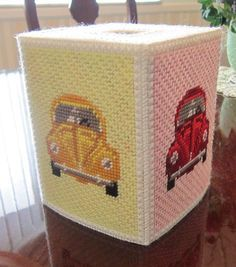 This tissue box is for the classic Volkswagen Beetle fan. Each side has the car in different colors. Stitched on 10-count plastic canvas.
