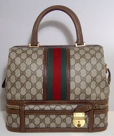 Vintage Gucci train case with key