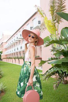 Swimsuit worn as top: Solid and Stripes . Skirt: PartySkirt . Hat: Eugenia Kim . Bag: Mansur Gavriel . Sunglasses: Old, similar he...