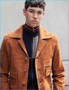 Jos Whiteman wears paneled wool cardigan and suede jacket CMMN SWDN.
