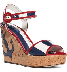 Taking inspiration from classic maritime style, this lofty cork wedge sandal fashioned with striped straps and a blue anchor appliqué is ideal for walking along the boardwalk and other seaside adventures.