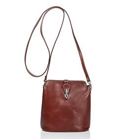 Gleaming hardware updates this leather crossbody bag's simple design, while a compact interior keeps essentials secure. A removable strap offers hands-free convenience. 7.5'' W x 7.5'' H x 3.2'' D19.7'' max. strap lengthLeatherLinedFlap closureTwo compartmentsInterior: one zip pocketExterior: one zip pocketRemovable strapMade in Italy Shipping note: This item is shipping from Italy. Allow extra time for its journey to you.