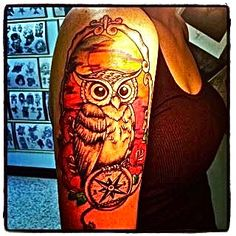 owl with compass