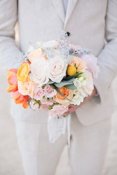 Love the coral, peach and yellow in contrast to the blush pinks in this bouquet