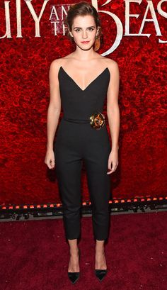 Emma Watson wears a plunging Oscar de la Renta strapless jumpsuit to the premiere of Beauty and the Beast in L.A.