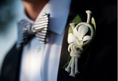 Nautical rope boutonniere with stripped tie. More of an outdoor wedding look, but really cute!