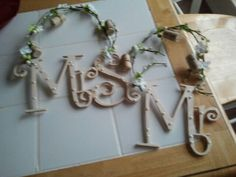 Made these signs to hang on our chairs at our wine theme wedding