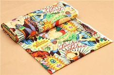 retro fabric with wrestlers in colourful costumes and Mexican wrestling masks