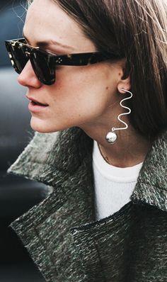 Woman wearing sculptural earring