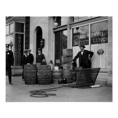 Bootleg Liquor Raid, 1923. Police posing with barrels of bootleg liquor they seized in a raid.