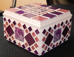 This Box was inspired by the two inter-linking hearts, which can be seen in the handmade tile on the side of the box.  I used light pink and purple glitter glass tiles with white grout which I tinted a very light pink.