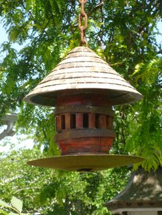 RUSTIC Utah Item # 1: Birdhouse made from wagon wheel hub, round shingled roof