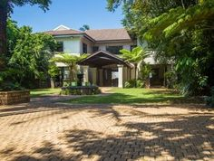 This 5 bedroom family home overlooks golf course and scenic ocean views in Durban North. Real Estate Business, Online Business, Internet Marketing Company, Beach Wood, Ocean Views, Luxury Homes, South Africa, Golf Courses, Home And Family