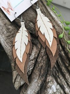 Items similar to Layered Leather Feather Earrings on Etsy - Handcrafted leather wrapped and sewn earrings. Each feather is individually cut and sewn by me. Diy Leather Earrings, Diy Earrings, Leather Keychain, Bijoux Diy, Leather Projects, Feather Earrings, Leather Accessories, Jewelry Accessories, Handcrafted Jewelry