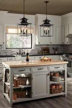 The charming Huntsville pendant light collection by Sea Gull Lighting features an updated profile reminiscent of traditional gas lanterns used in the 18th century. The open silhouette and top chimney detail create a warm and inviting look. Pendant lights are often paired or clustered together in a large foyer, over a kitchen island or dining room table.
