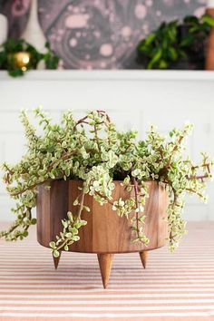 SEE ALL   |   12 OF 14    Wooden Planter It's no secret that potted greens can do wonders for a space, especially one that is lacking in color. This mid-century modern-inspired planter only requires a wooden bowl, ring display cones, and some epoxy cement. We know what we're doing this weekend.   Previous  PHOTOGRAPHY BY MANDI JOHNSON.  Next