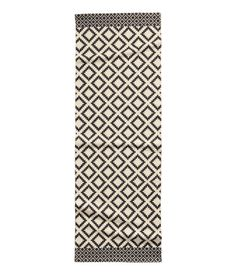 Rectangular cotton rug with a printed pattern at front. Patterned Cotton Rug  $34.99  . Size: SIZE  28X79  .
