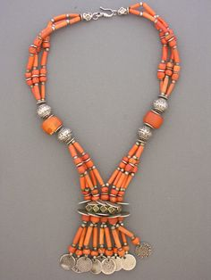 by Moroccan Designer Fouzi | A magnificent collection of antique undyed coral beads, matched with four antique Tiznit silver beads from the early 1930s. The hexagonal silver beads between the rows of coins are worn by the Tuareg and Saharwi peoples for protection. The coins which finish this piece are all pre-1930. | 4'495$