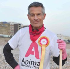 Guy models the Animal Welfare Party bandana - screen printed using vegan ink. the perfect way for non-humans and humans to show support for our campaign. Available to purchase on-line at the link here: https://www.etsy.com/uk/listing/184733007/animal-welfare-party-bandana
