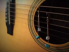 Recycled Guitar String EarringsTurquoise & Crystal AccentsNickle Plated Guitar Strings. Tarnish Free!