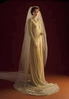 "Wedding Dress and Veil, Madeleine Vionnet (France, 1876-1975): ca .1930-1934, French, chiffon velvet (dress), silk net, silk flowers (veil). ""Diamond, Ellen and Diamond, Jay.  The Word of Fashion.  New York: Fairchild Books, 2002.""  