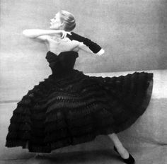 Model wearing a gown by Pierre Balmain for Vogue Paris, 1951.