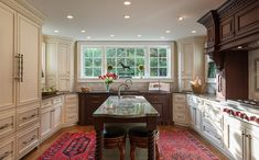A mixture of finishes, textures and styles in this over the top traditional kitchen