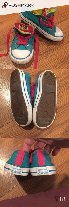 Worn once Sz 9 kids Converse Chuck Taylors Great condition pair of Chuck Taylors Sz 9. Cute detail with the double tongues to show the pink or not. Converse Shoes Sneakers