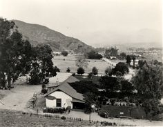 A panoramic view of Verdugo Canyon with El Roble de la Paz, the Verdugo Adobe, at 2211 Bonita Drive in Glendale, visible, 1911. The adobe is the last of five built by Teadoro Verdudo in 1860. Glendale Central Public Library. San Fernando Valley History Digital Library.