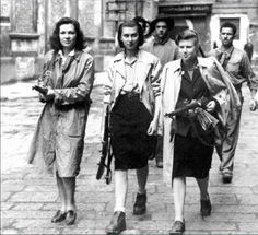 French women of the Resistance openly carrying their weapons. Activated by coded radio messages just prior to the Allied landings they set out to destroy communications centers, blow up rail lines and disrupt as much travel as possible. Prior to this they operated under occupation hiding downed airmen, committing sabotage and hiding Jews trying to escape. Their penalty was always death if caught.
