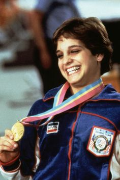 Inspiring Olympic Moment: Mary Lou Retton is the First American Gymnast to Win Gold Olympics gymnastics opened to women in 1952 and was mostly dominated by Eastern European athletes...until American gymnast Mary Lou Retton won gold for the all-around competition at the 1984 Los Angeles Games. Her win inspired a generation of girls to learn gymnastics, and she went on to win a total of five medals that year, the most of any athlete in the Games.