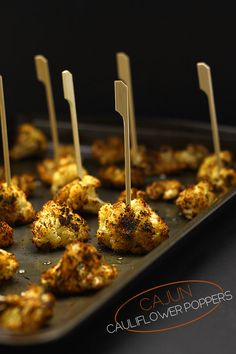 Cajun Cauliflower Poppers - a lightened-up appetizer recipe with tons of flavour. Just roast up and serve.