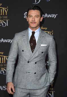 Luke Evans Photos Photos - Actor Luke Evans attends the world premiere of Disney's Beauty and the Beast at El Capitan Theatre in Hollywood, California on March 2, 2017. / AFP PHOTO / VALERIE MACON - Premiere Of Disney's 'Beauty And The Beast' - Arrivals