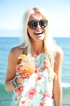 girl-laughing-at-beach-house http://itgirlweddings.com/11-essentials-for-your-bachelorette-party-beach-weekend/