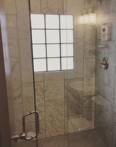 "Marble shower featuring polished Italian Bianco Carrara marble walls - 12x24"" field tile - and Carrara marble square mosaic tile shower floor. Marble walk-in shower tile ideas - Carrara bathroom tile - Carrara marble shower."