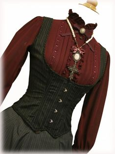 waistcoat-ey corset. At last! I am after all a librarian not a pirate - this idea is more like it :-)