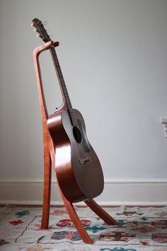 Whether you're shopping for a musical dad or a talented grad, this handcrafted cherry-wood guitar stand strikes a thoughtful note. #etsyfinds