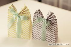 Learn how to make these cute origami gift bags! Easy to follow video tutorial. Perfect as easter gift box, party favour, wedding favour!