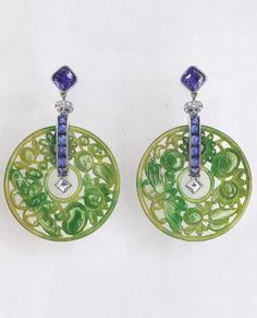 A pair of Art Deco jade, diamond, sapphire and platinum earrings, by Cartier. Image courtesy of Liberty London Christmas catalogue, 2015. #Cartier #ArtDeco #earrings