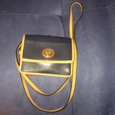 Coach Turnlock mini crossbody Used but taken care of.  Colors consist of Navy blue, Vermillion, and Saddle. Coach Bags Crossbody Bags