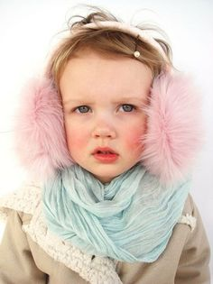 Sweet girl with pink fluffy ear muffs