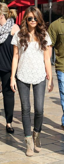 Trendy and chic in an ivory lace top, skinny jeans, and tan suede laced up ankle boots.