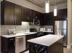 Contemporary Kitchen with Ikea EKESTAD Cabinet Doors, Limestone counters, Undermount sink, High ceiling, Glass Tile, Flush